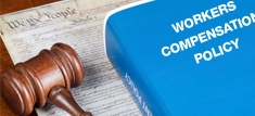 Gavel with Workers' Compensation policy book